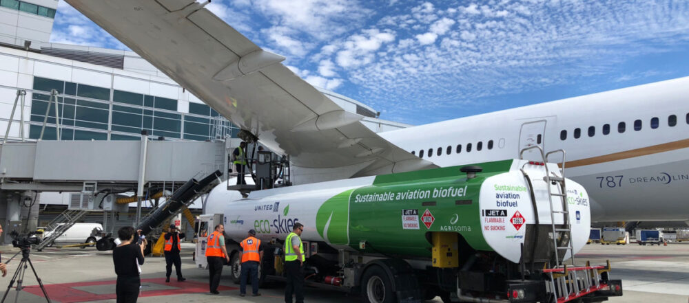 An engineer refuels the aircraft from the truck